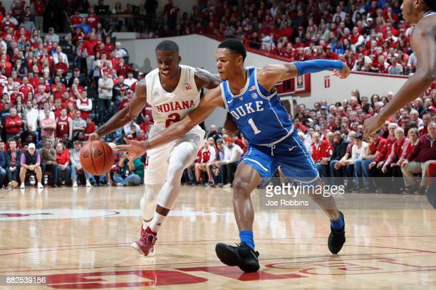 Trevon Duval of the Duke Blue Devils defends against Josh Newkirk of the Indiana Hoosiers in the first half of a game at Assembly Hall on November 29...