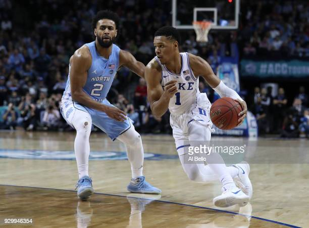 Trevon Duval of the Duke Blue Devils drives against Joel Berry II of the North Carolina Tar Heels during the semifinals of the ACC Men's Basketball...