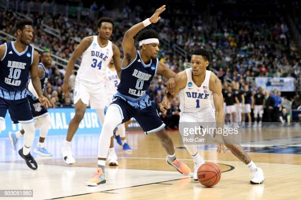 Trevon Duval of the Duke Blue Devils drives to the basket against EC Matthews of the Rhode Island Rams during the first half in the second round of...