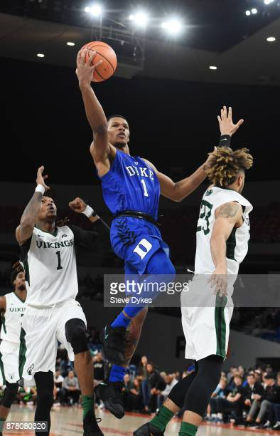 Trevon Duval of the Duke Blue Devils drives to the basket on Tyrell Henderson and Holland Woods of the Portland State Vikings during the second half...