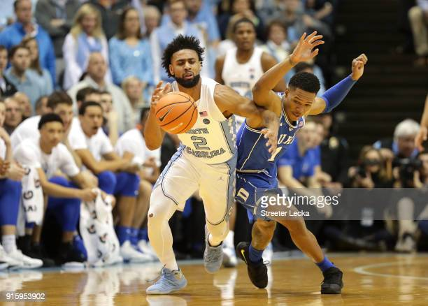 Trevon Duval of the Duke Blue Devils goes after a loose ball against Joel Berry II of the North Carolina Tar Heels during their game at Dean Smith...