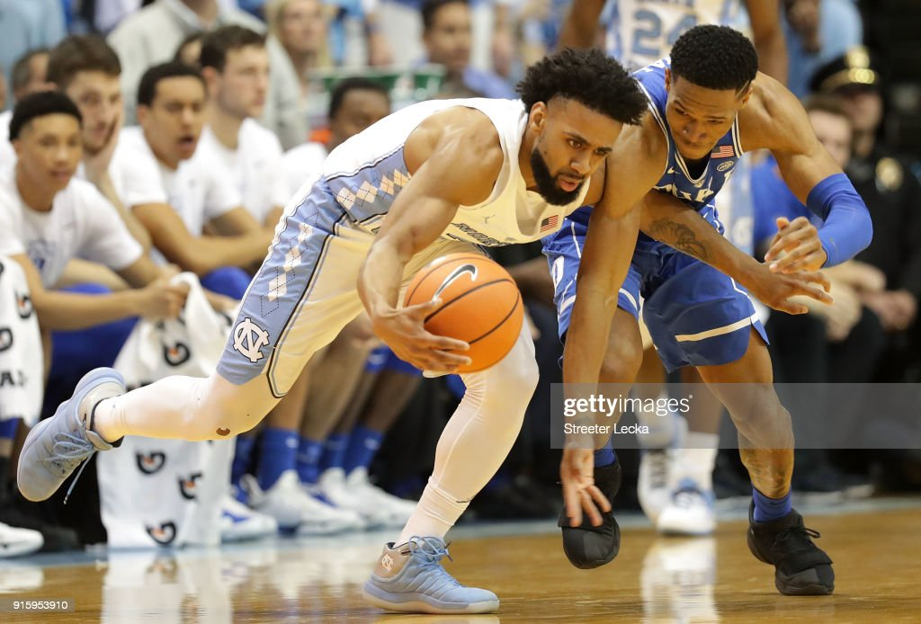 Trevon Duval #1 of the Duke Blue Devils goes after a loose ball against Joel Berry II #2 of the North Carolina Tar Heels during their game at Dean Smith Center on February 8, 2018 in Chapel Hill, North Carolina.