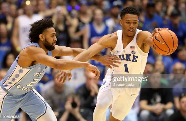 Trevon Duval of the Duke Blue Devils goes after a loose ball against Joel Berry II of the North Carolina Tar Heels during their game at Cameron...
