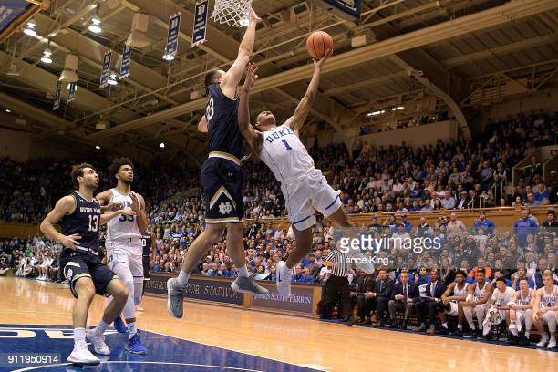 Trevon Duval of the Duke Blue Devils goes to the basket against John Mooney of the Notre Dame Fighting Irish at Cameron Indoor Stadium on January 29...