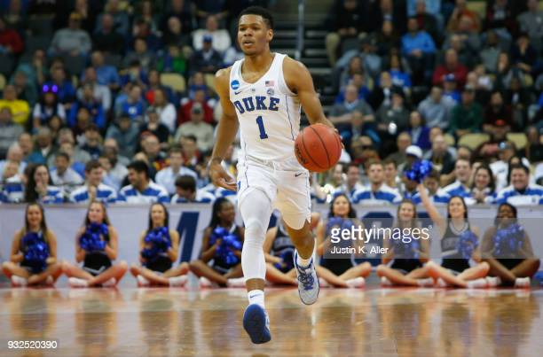 Trevon Duval of the Duke Blue Devils keeps possession of the ball aganst the Iona Gaels during the first half of the game in the first round of the...