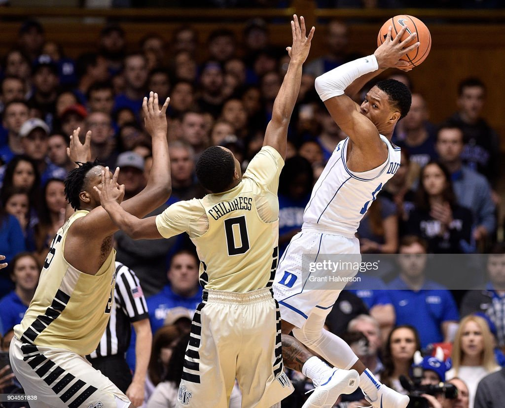 Trevon Duval #1 of the Duke Blue Devils looks to pass as he drives against Sam Japhet-Mathias #25 and Brandon Childress #0 of the Wake Forest Demon Deacons during their game at Cameron Indoor Stadium on January 13, 2018 in Durham, North Carolina. Duke won 89-71.