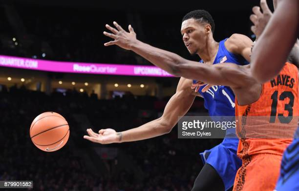 Trevon Duval of the Duke Blue Devils passes the ball as Kevarrius Hayes of the Florida Gators defends in the second half of the game during the...