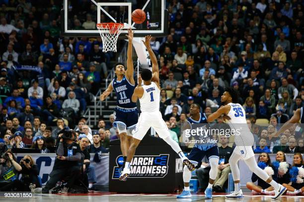 Trevon Duval of the Duke Blue Devils shoots the ball against Jeff Dowtin of the Rhode Island Rams during the first half in the second round of the...
