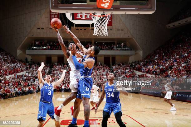 Trevon Duval Wendell Carter Jr #34 and Grayson Allen of the Duke Blue Devils defend against Robert Johnson of the Indiana Hoosiers in the second half...