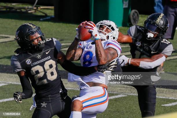 Trevon Grimes of the Florida Gators catches a touchdown against the Vanderbilt Commodores during the first half at Vanderbilt Stadium on November 21,...