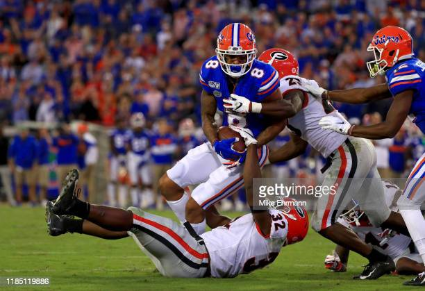 Trevon Grimes of the Florida Gators is tackled by Monty Rice of the Georgia Bulldogs during a game on November 02, 2019 in Jacksonville, Florida.