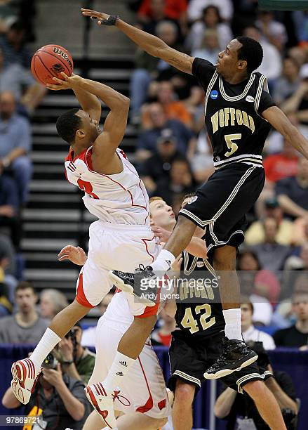 Trevon Hughes of the Wisconsin Badgers shoots over Jamar Diggs of the Wofford Terriers during the first round of the 2010 NCAA men's basketball...