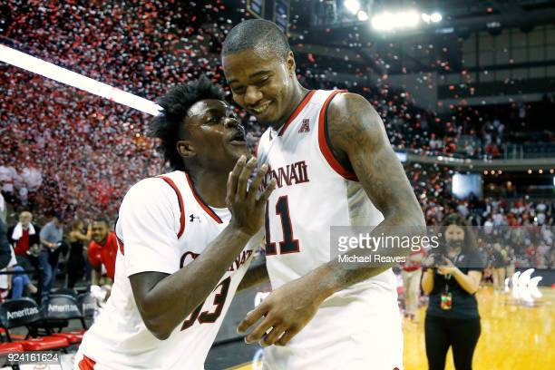 Trevon Scott of the Cincinnati Bearcats celebrates with Gary Clark after defeating the Tulsa Golden Hurricane 8274 at BBT Arena on February 25 2018...