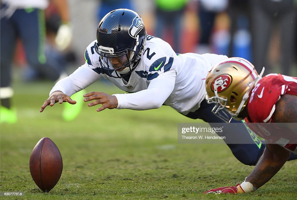 Trevone Boykin #2 of the Seattle Seahawks dives on his own fumble against the San Francisco 49ers during the fourth quarter of their NFL football game at Levi's Stadium on January 1, 2017 in Santa Clara, California.
