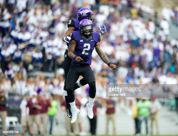Trevone Boykin of the TCU Horned Frogs celebrates with Josh Doctson after the two connected on a 9 yard touchdown pass from Boykin against the...