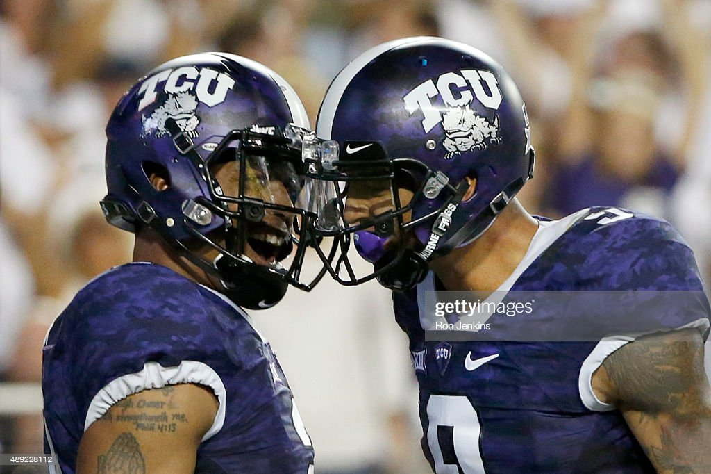 Trevone Boykin #2 of the TCU Horned Frogs celebrates with teammate Josh Doctson #9 after Boykin scored on a touchdown run in the second quarter against the Southern Methodist Mustangs at Amon G. Carter Stadium on September 19, 2015 in Fort Worth, Texas.