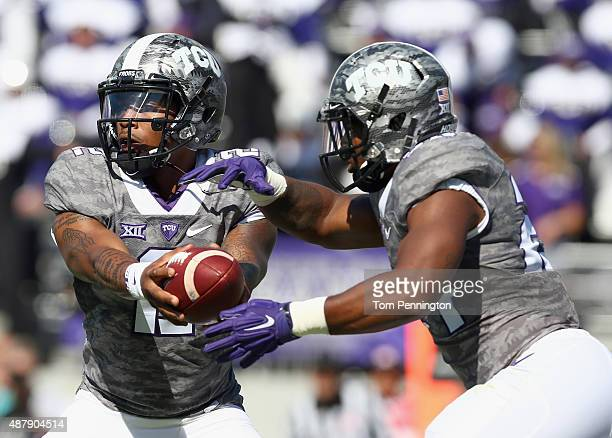 Trevone Boykin of the TCU Horned Frogs hands the ball off to Trevorris Johnson of the TCU Horned Frogs in the second quarter against the Stephen F...