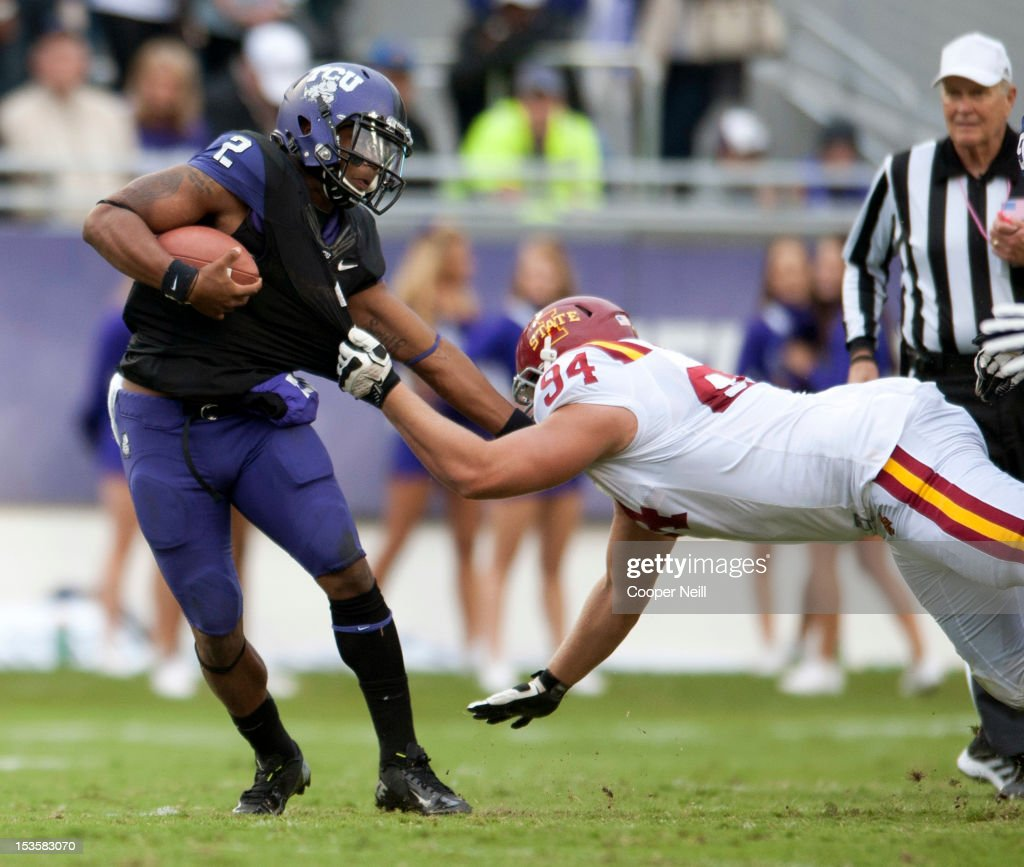 Trevone Boykin #2 of the TCU Horned Frogs is chased down by Jake McDonough #94 during the Big 12 Conference game against the Iowa State Cyclones on October 6, 2012 at Amon G. Carter Stadium in Fort Worth, Texas.