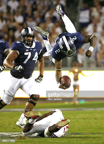 Trevone Boykin of the TCU Horned Frogs is sent flying after being hit by Kyran Mitchell of the Southern Methodist Mustangs as Halapoulivaati Vaitai...