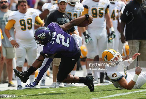 Trevone Boykin of the TCU Horned Frogs is tackled by Trenon Trosclair of the Southeastern Louisiana Lions at Amon G. Carter Stadium on September 7,...