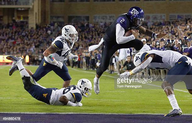 Trevone Boykin of the TCU Horned Frogs scores a touchdown against Daryl Worley of the West Virginia Mountaineers in the first quarter at Amon G...