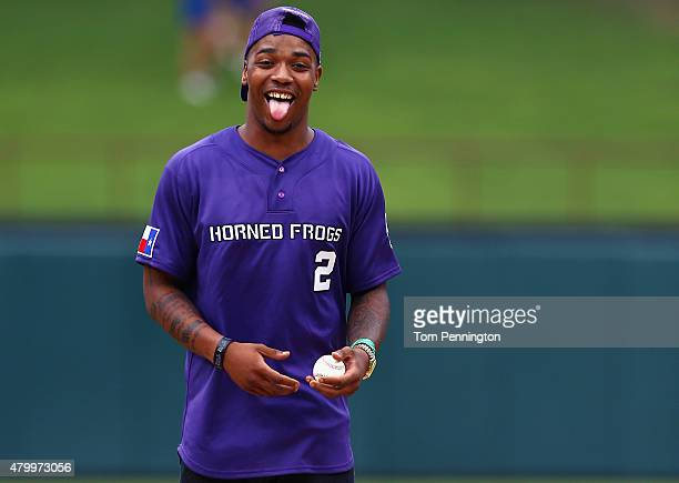 Trevone Boykin quarterback of the TCU Horned Frogs reacts before throwing out the ceremonial first pitch before the Arizona Diamondbacks take on the...