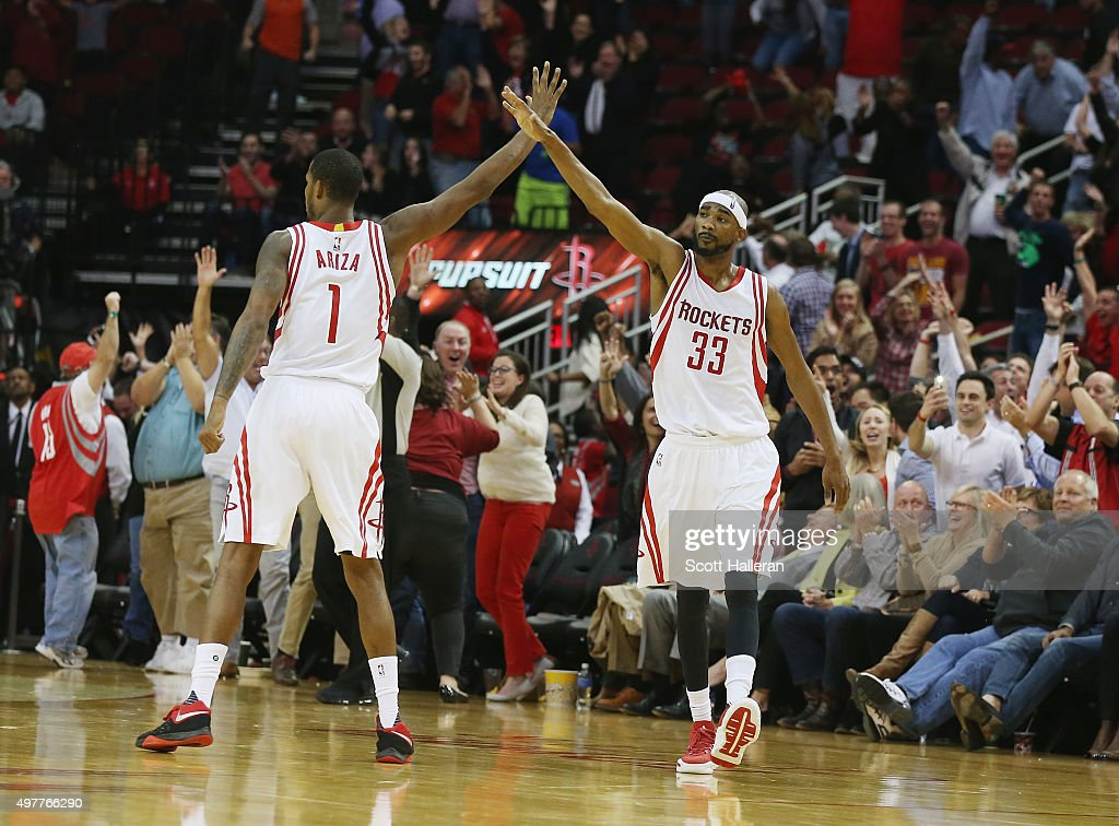 Trevor Ariza #1 and Corey Brewer #33 of the Houston Rockets celebrate after Brewer hit a three-point shot near the end of the fourth quarter against the Portland Trail Blazers during their game at the Toyota Center on November 18, 2015 in Houston, Texas.