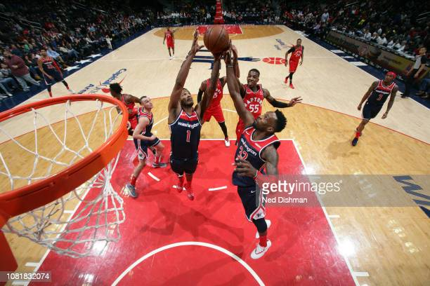 Trevor Ariza and Jeff Green of the Washington Wizards go for a rebound against the Toronto Raptors on January 13 2019 at Capital One Arena in...