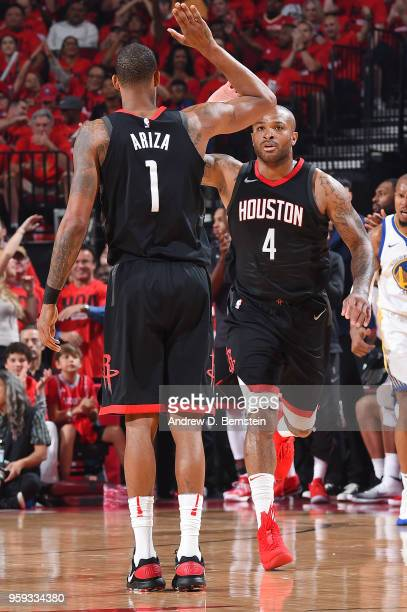 Trevor Ariza and PJ Tucker of the Houston Rockets high five during the game against the Golden State Warriors during Game Two of the Western...