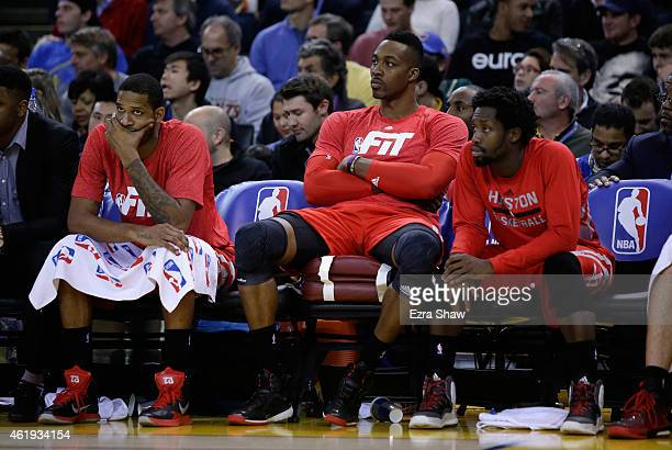 Trevor Ariza Dwight Howard and Patrick Beverley of the Houston Rockets sit on the bench during the final quarter of their loss to the Golden State...