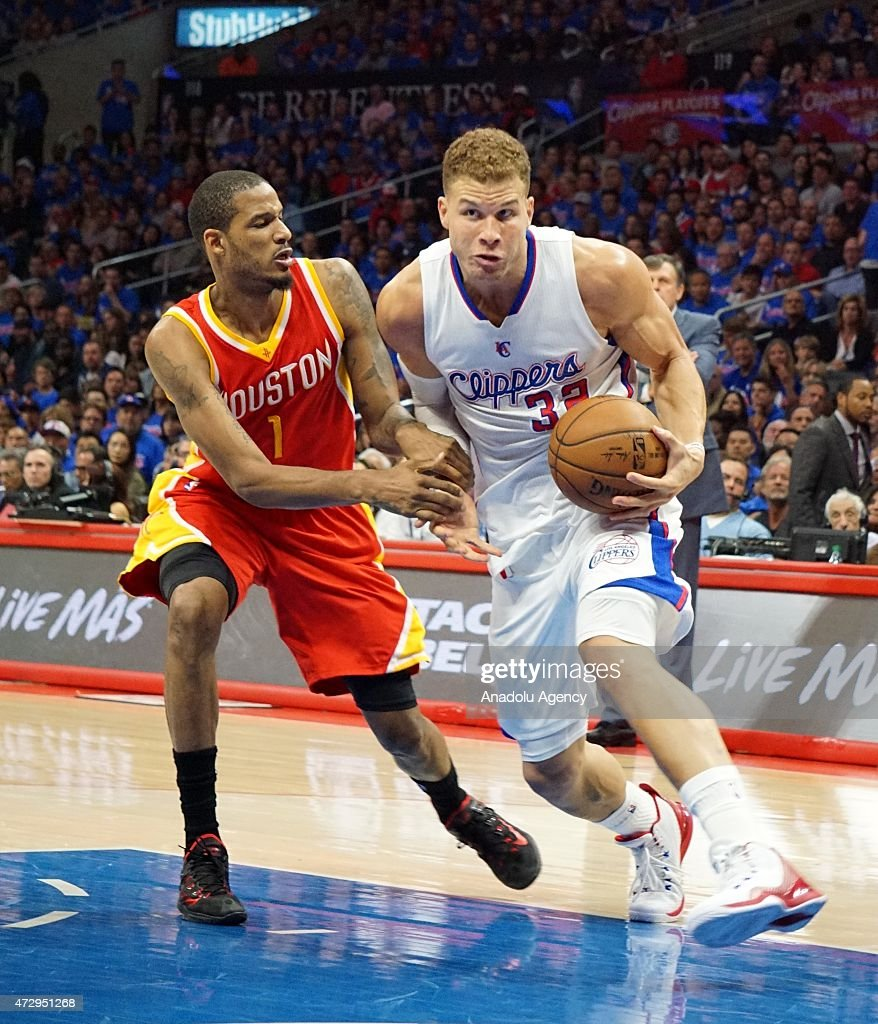 Trevor Ariza of Houston Rockets (L) and Blake Griffin of Clippers (R) in action during the NBA playoff game between Houston Rockets and Los Angeles Clippers at the Stapless Center, Los Angeles on May 10, 2015.