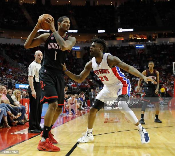 Trevor Ariza of the Houston Rockets controls the ball defended by Reggie Bullock of the Detroit Pistons in the first half at Toyota Center on April 7...