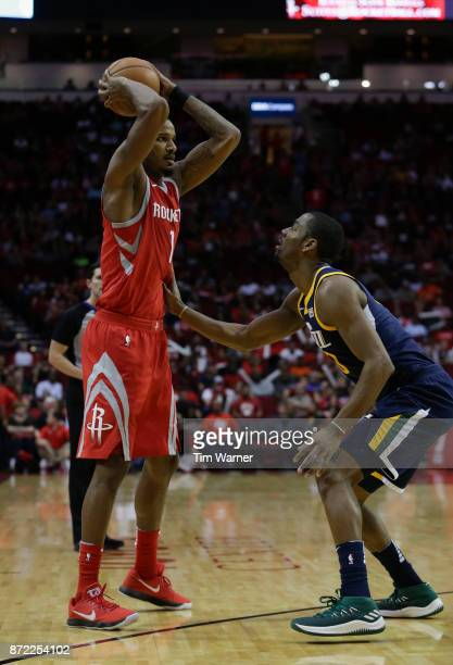 Trevor Ariza of the Houston Rockets controls the ball defended by Alec Burks of the Utah Jazz in the second half at Toyota Center on November 5 2017...