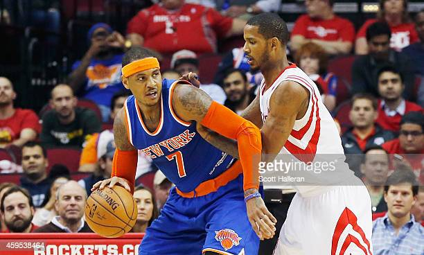 Trevor Ariza of the Houston Rockets defends against Carmelo Anthony of the New York Knicks during their game at the Toyota Center on November 24 2014...