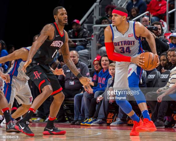 Trevor Ariza of the Houston Rockets defends against Tobias Harris of the Detroit Pistons during the an NBA game at Little Caesars Arena on January 6...