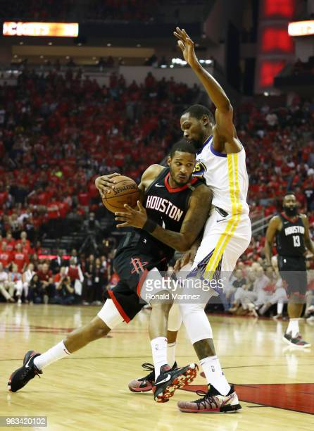Trevor Ariza of the Houston Rockets drives against Kevin Durant of the Golden State Warriors In the first half of Game Seven of the Western...