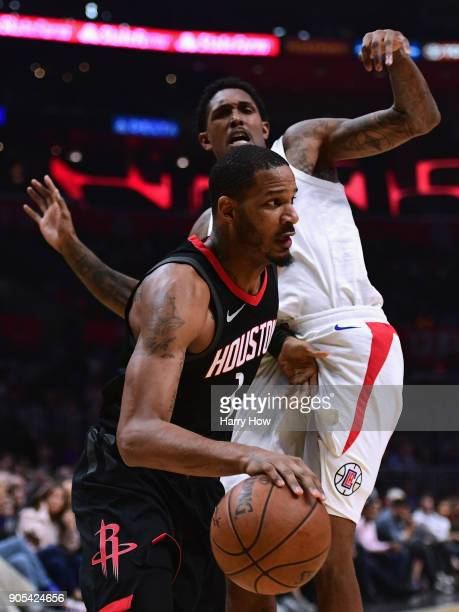 Trevor Ariza of the Houston Rockets drives past Lou Williams of the LA Clippers during the first half at Staples Center on January 15 2018 in Los...