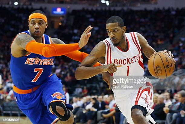 Trevor Ariza of the Houston Rockets drives with the basketball against Carmelo Anthony of the New York Knicks during their game at the Toyota Center...