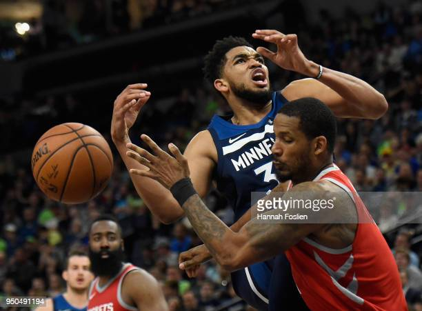 Trevor Ariza of the Houston Rockets fouls KarlAnthony Towns of the Minnesota Timberwolves while shooting the ball during the fourth quarter in Game...