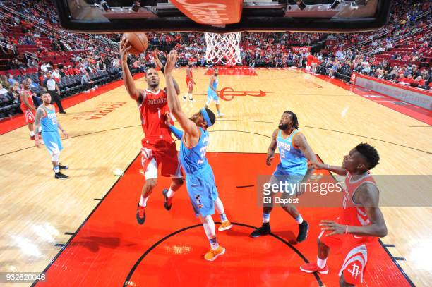 Trevor Ariza of the Houston Rockets goes to the basket against the LA Clippers on March 15 2018 at the Toyota Center in Houston Texas NOTE TO USER...