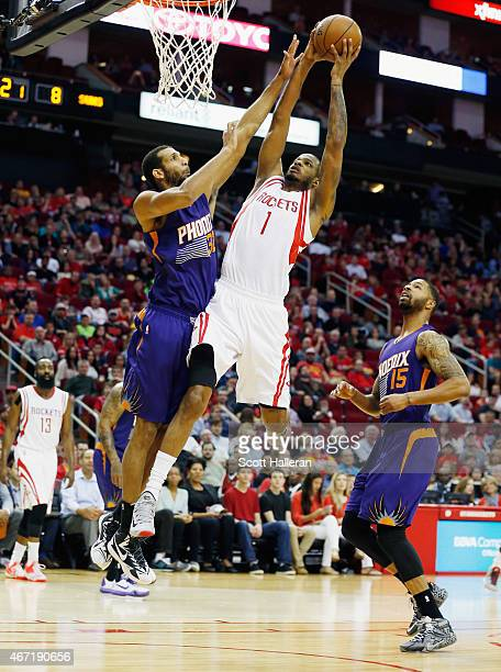 Trevor Ariza of the Houston Rockets goes up for a shot against Brandan Wright of the Phoenix Suns during their game at the Toyota Center on March 21...