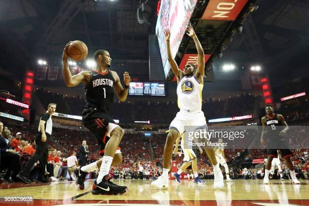 Trevor Ariza of the Houston Rockets looks to pass against Kevon Looney of the Golden State Warriors in the first quarter of Game Two of the Western...