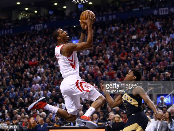 Trevor Ariza of the Houston Rockets shoots the ball as Kyle Lowry of the Toronto Raptors defends during the first half of an NBA game at Air Canada...