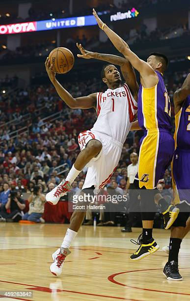 Trevor Ariza of the Houston Rockets takes a shot over Jeremy Lin of the Los Angeles Lakers during their game at the Toyota Center on November 19 2014...