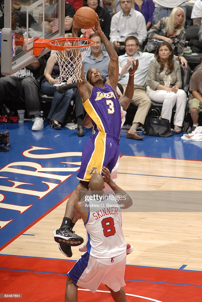 Trevor Ariza #3 of the Los Angeles Lakers goes up for a dunk against Brian Skinner #8 of the Los Angeles Clippers at Staples Center on October 29, 2008 in Los Angeles, California.