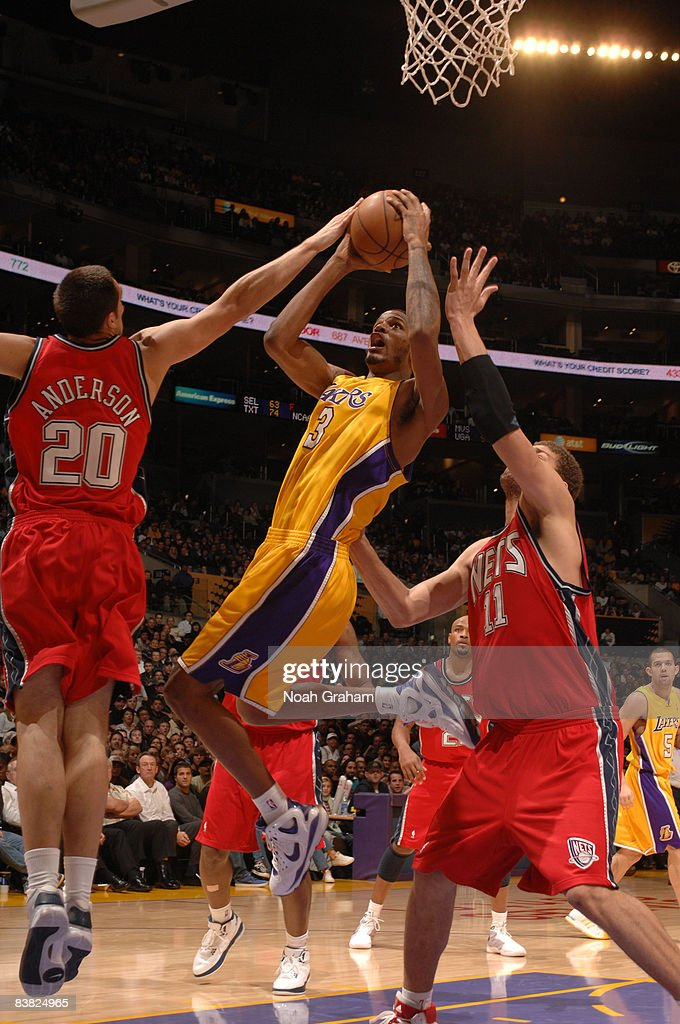 Trevor Ariza #3 of the Los Angeles Lakers goes up for a shot against Ryan Anderson #20 of the New Jersey Nets at Staples Center on November 25, 2008 in Los Angeles, California.