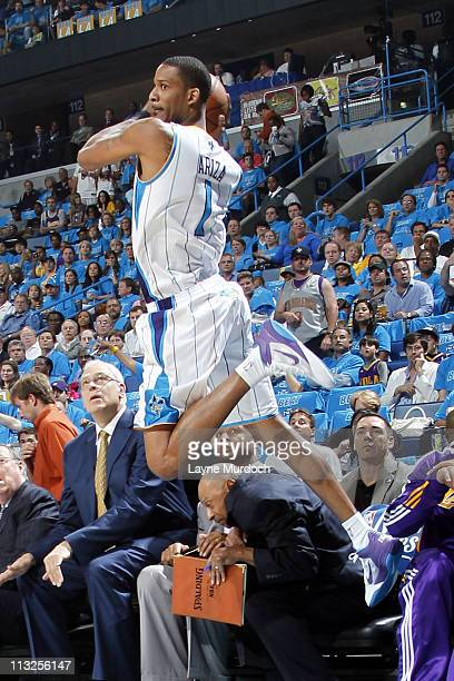 Trevor Ariza of the New Orleans Hornets saves the ball from going out of bounds against the Los Angeles Lakers in Game Six of the Western Conference...