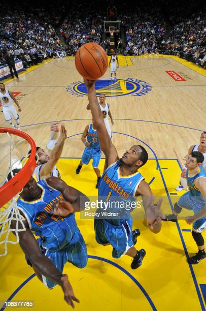 Trevor Ariza of the New Orleans Hornets scores inside against the Golden State Warriors on January 26 2011 at Oracle Arena in Oakland California NOTE...