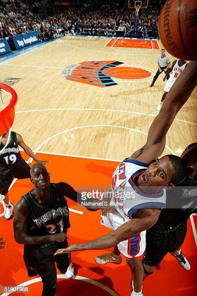 Trevor Ariza of the New York Knicks attempts dunk against Kevin Garnett and Eddie Griffin of the Minnesota Timberwolves on December 29 2004 at...