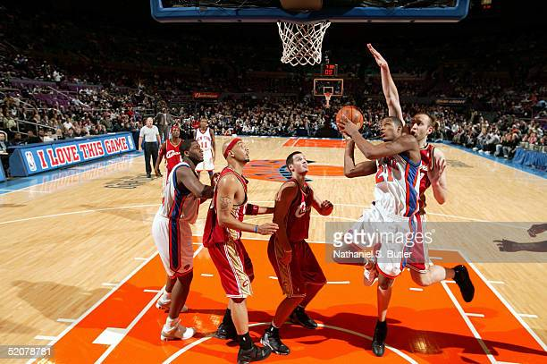Trevor Ariza of the New York Knicks attempts layup against Zydrunas Ilgauskas and Aleksandar Pavlovic of the Cleveland Cavaliers on January 28 2005...